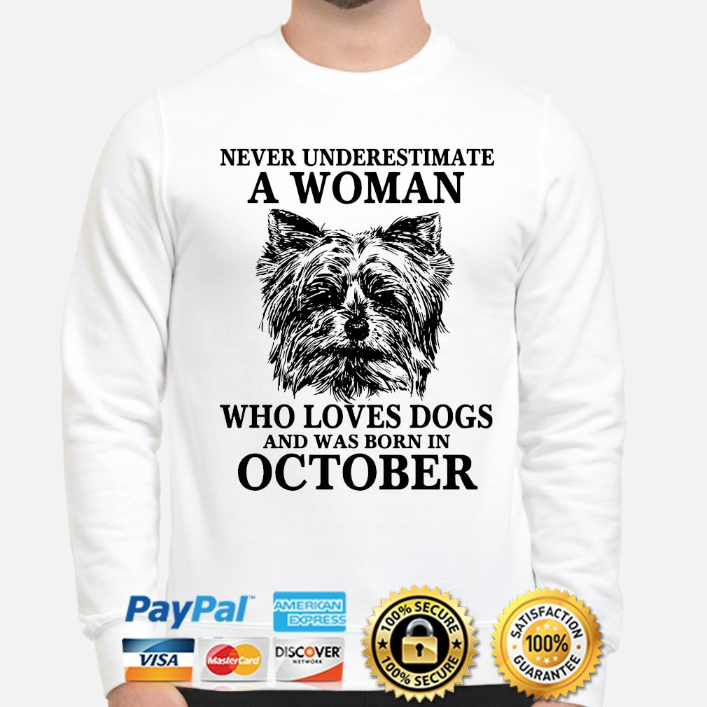 Never underestimate a woman who loves dogs and was born in October s sweater